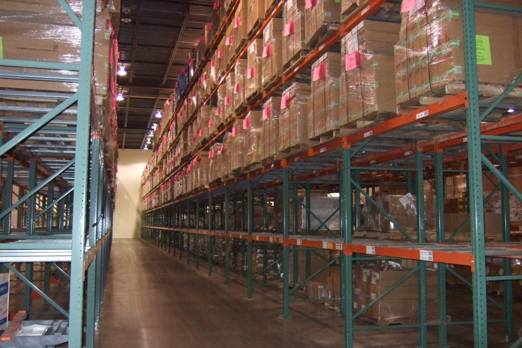 a warehouse aisle lined with tall pallet rackes